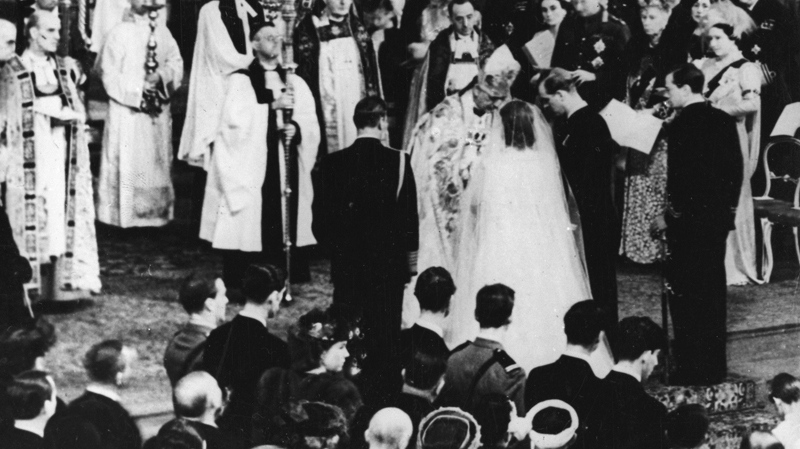 Bridegroom Philip Mountbatten (Duke of Edinburgh), right centrr, places the wedding ring on the bride's (Princess Elizabeth) finger at Westminster Abbey, Nov. 20, 1947 (AP)