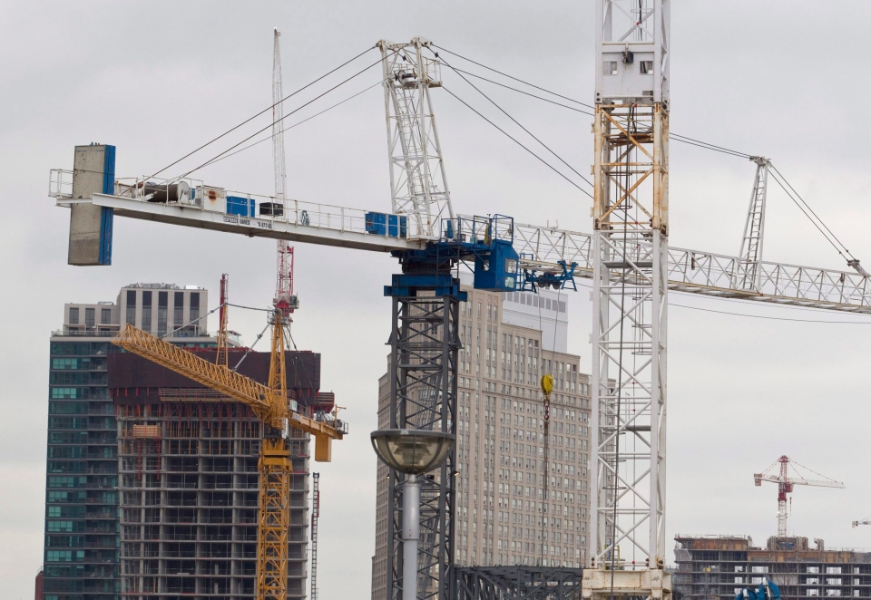 Construction cranes in downtown Toronto on Saturday, Feb. 4, 2012. (Pawel Dwulit / THE CANADIAN PRESS)