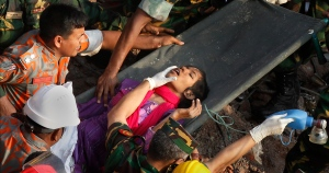 Survivor Reshma Begum lies on a stretcher after being pulled out from the rubble of a building that collapsed in Savar, near Dhaka, Bangladesh, Friday, May 10, 2013. (AP)
