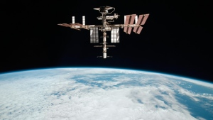 This May 23, 2011 file photo released by NASA shows the International Space Station at an altitude of approximately 220 miles above the Earth, taken by Expedition 27 crew member Paolo Nespoli from the Soyuz TMA-20 following its undocking. (AP Photo/NASA, Paolo Nespoli, File)