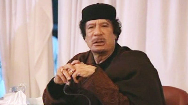 Libyan leader Moammar Gadhafi speaks while appearing on state TV on Tuesday, March 15, 2011. (AP  / Libya State TV)