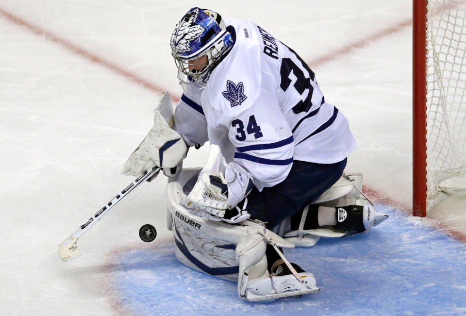Toronto Maple Leafs goalie James Reimer makes a save against the Boston Bruins during the third period in Game 5 of an NHL hockey Stanley Cup playoff series in Boston on Friday, May 10, 2013. (AP Photo/Charles Krupa)