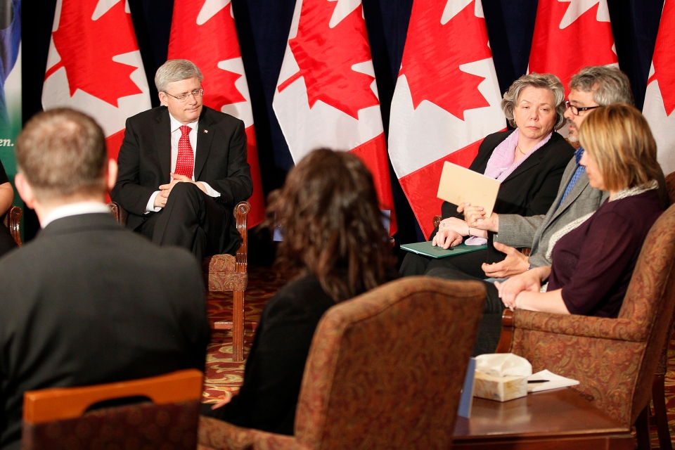 Prime Minister Stephen Harper participates in a round table in Winnipeg to discuss solutions to cyberbullying, Friday, May 10, 2013. (John Woods / THE CANADIAN PRESS)