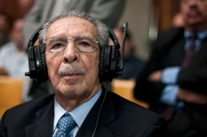 Guatemala's former dictator Jose Efrain Rios Montt wears headphones as he listens to the verdict in his genocide trial in Guatemala City, Friday, May 10, 2013. (AP / Luis Soto)
