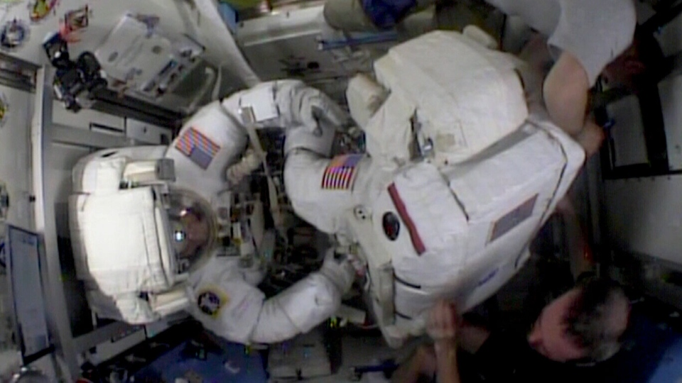 Chris Cassidy and Tom Marshburn prepare for a spacewalk to repair a leak on the ISS, Saturday, May 11, 2013.