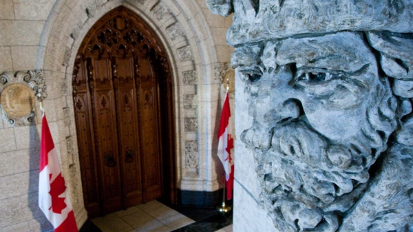 A stone carving overlooks the front doors to the House of Commons which is not sitting for March break on Parliament Hill in Ottawa on Monday, March 14, 2011. (Sean Kilpatrick / THE CANADIAN PRESS)