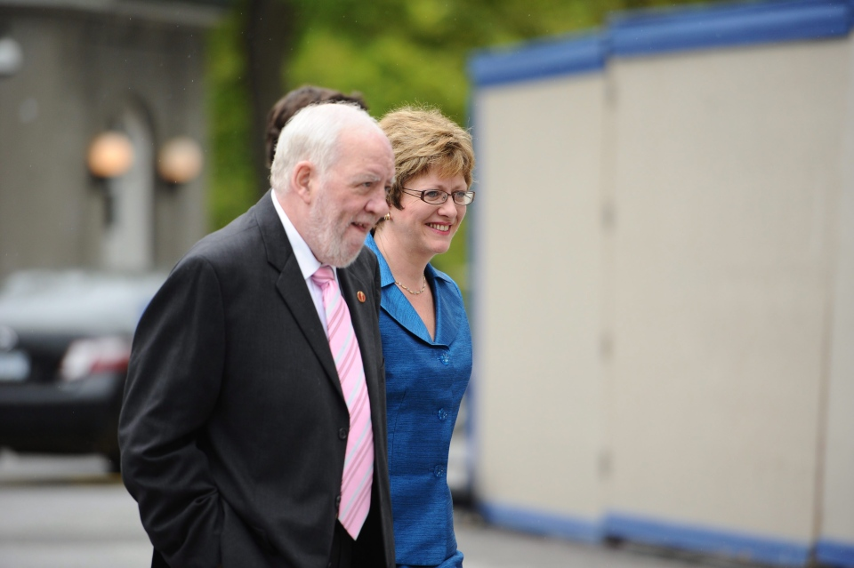 MP Diane Finley (rear) and husband Senator Doug Finley arrives for a cabinet shuffle at Rideau Hall in Ottawa on Wednesday, May 18, 2011. (Sean Kilpatrick / THE CANADIAN PRESS)
