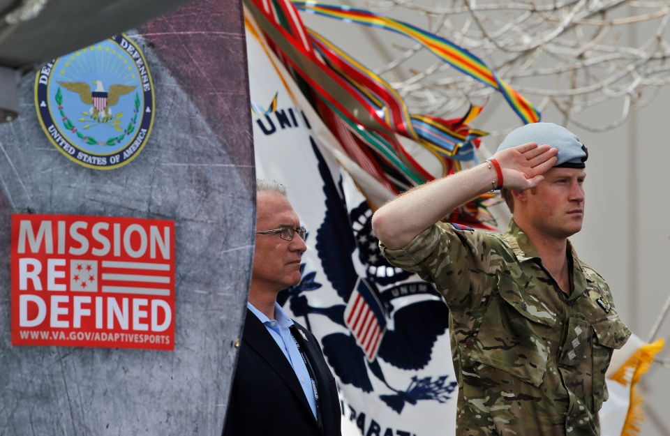 Prince Harry salutes during the opening ceremony for the 2013 Warrior Games, at the U.S. Olympic Training Center, in Colorado Springs, Colo., Saturday, May 11, 2013. (AP / Brennan Linsley)