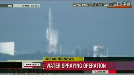 An aerial spray takes place at the No. 3 reactor at Fukushima Dai-ichi plant, Thursday, March 17, 2011. (NHK World)