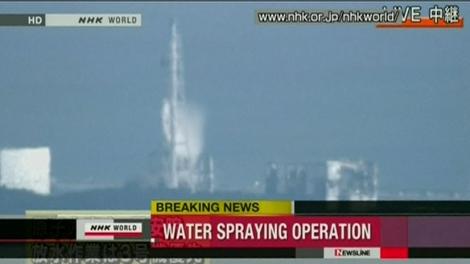 An aerial spray takes place at the No. 3 reactor at Fukushima Dai-ichi plant, Thursday, March 17, 2011. (NHK World)