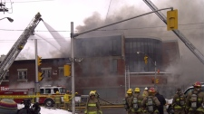 Firefighters attack the blaze on Beechwood Avenue from all angles, and officials are warning people of toxic fumes, Wednesday, March 16, 2011.