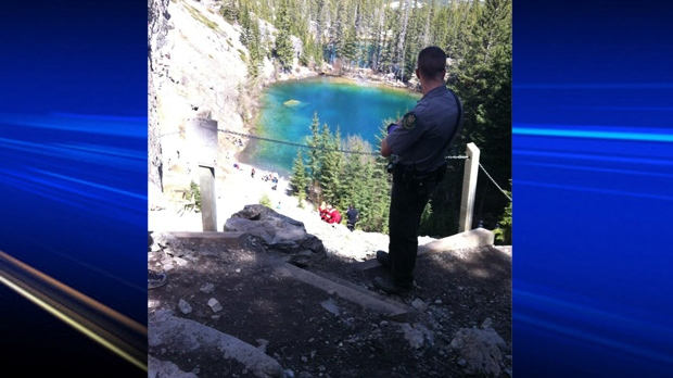 An emergency responder oversees the retrieval of an injured woman from an area near Grassi Lakes (photo courtesy Shanelle Brade)