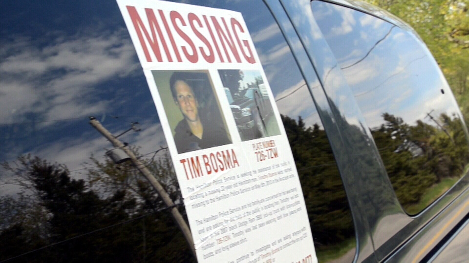 A 'missing' poster of Timothy Bosma is displayed on an RCMP vehicle in Hamilton, Ont.