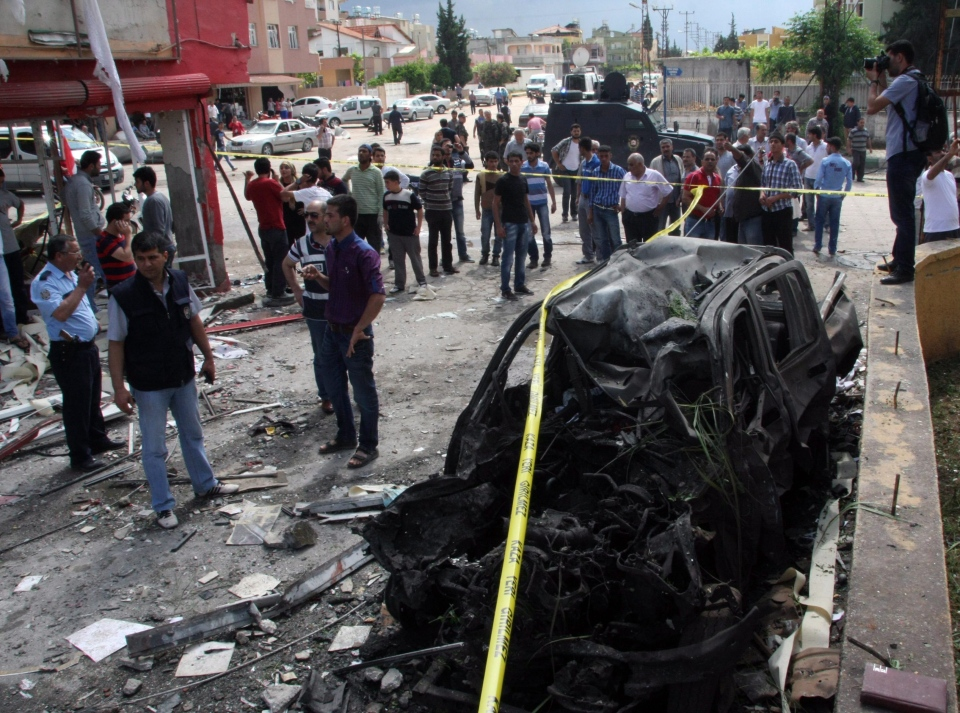 The site of one of explosions after several explosions killed at least 40 people and injured dozens in Reyhanli, near Turkey's border with Syria, Saturday, May 11, 2013, Turkish Interior Minister Muammer Guler said. (AP / IHA)