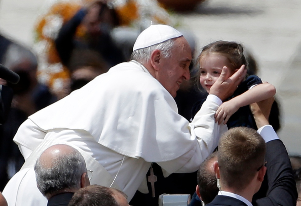 Pope Francis kisses a baby at the end of a canonization mass in St. Peter's Square at the Vatican, Sunday, May 12, 2013. (AP / Gregorio Borgia)