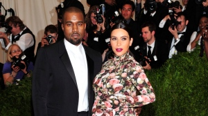 "Kanye West and Kim Kardashian attends The Metropolitan Museum of Art's Costume Institute benefit celebrating ""PUNK: Chaos to Couture"" on Monday May 6, 2013 in New York. (Photo by Charles Sykes / Invision / AP)"