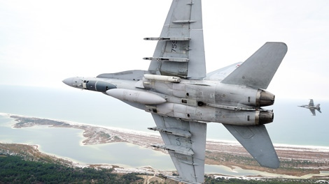 A CF-18 fighter jet is seen in flight during Exercise Combat Archer, which was held in Tyndall, Florida on Tuesday, Feb. 22, 2011. (Cpl. Pierre Habib / DND)