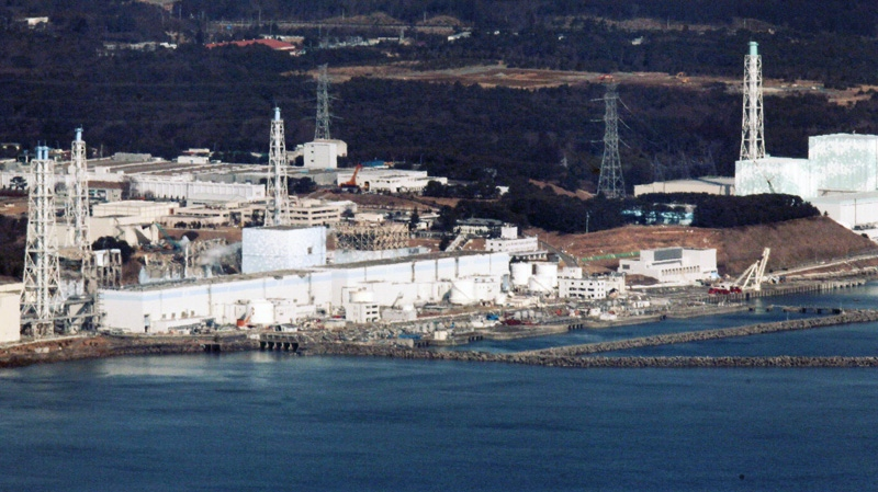 Fukushima Dai-ichi nuclear power plant is pictured before helicopters dump water on the stricken reactor to cool overheated fuel rods inside the core in Okumamachi, Fukushima Prefecture, Japan, Thursday, March 17, 2011. (AP / Kyodo News)