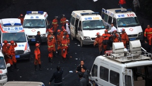 In this Saturday, May 11, 2013 photo, rescuers and ambulances prepare near the Dashan Coal Mine in Pingba county in southwest China's Guizhou province. (AP)