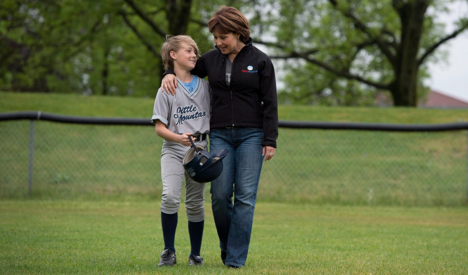 BC Liberal leader Christy Clark spends some time with her son Hamish Marrisen-Clark, 11, prior to his baseball game in Vancouver, B.C. Sunday, May 12, 2013. British Columbians will go to the polls May 14th. (THE CANADIAN PRESS/Jonathan Hayward)