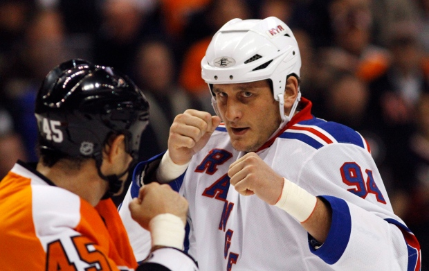 Philadelphia Flyers' Jody Shelley, left, and New York Rangers' Derek Boogaard fight during an NHL hockey game in Philadelphia, Nov. 4, 2010. (AP / Matt Slocum)