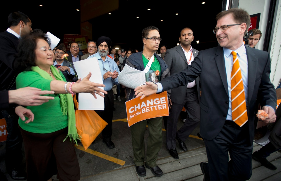 BC NDP leader Adrian Dix greets supporters as he leaves a rally in Vancouver, B.C. Sunday, May 12, 2013. British Columbians will go to the polls May 14th. THE CANADIAN PRESS/Jonathan Hayward