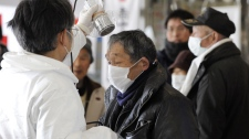 A man is screened for radiation exposure at an evacuation center at Fukushima, northeastern Japan, on Thursday, March 17, 2011. (Kyodo News)