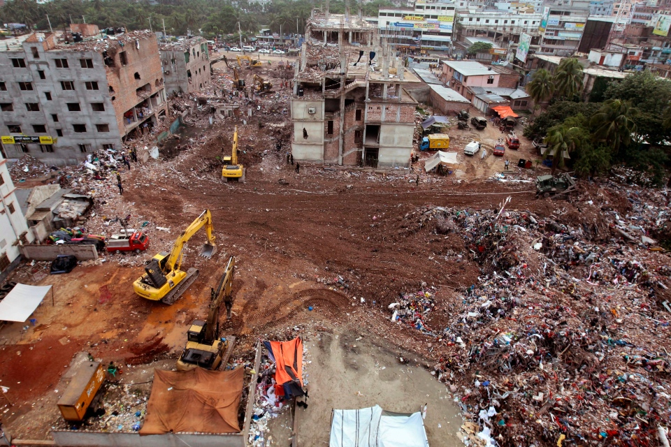 Bangladeshi rescuers use heavy machinery to clear rubble of a garment factory building that collapsed on April 24 as they continued searching for bodies in Savar, near Dhaka, Bangladesh, on May 12, 2013. (AP / A.M. Ahad)