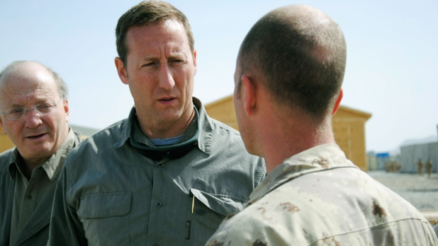 Defence Minister Peter MacKay speaks with a Canadian troop while visiting a forward operating base in Zangabad, Afghanistan on Thursday, March 17, 2011. (Tara Brautigam / THE CANADIAN PRESS)