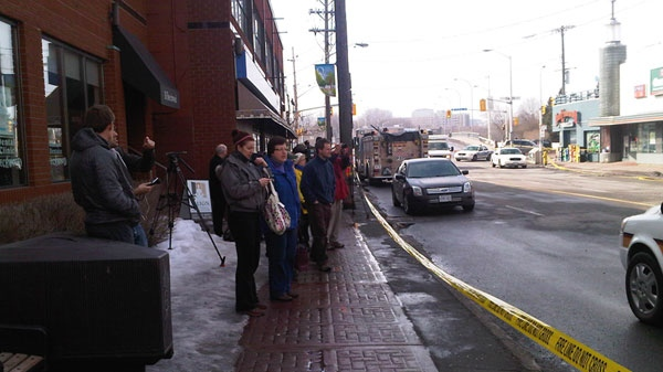 Onlookers take in the damage from a fire that destroyed a popular strip on Beechwood Avenue, Thursday, March 17, 2011.