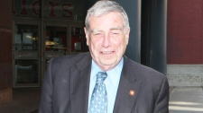 Bruce Carson walks to a Hy's Steakhouse in Ottawa, May 1, 2008. (Jake Wright / THE CANADIAN PRESS)