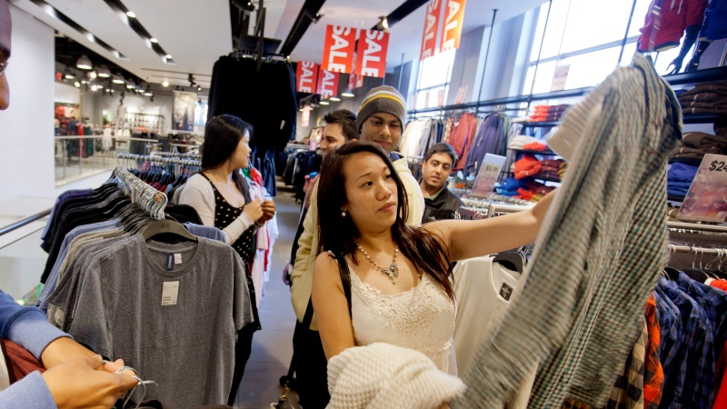 Shopping at an H&M store in Atlanta, on Dec. 12, 2012. (AP / David Goldman)