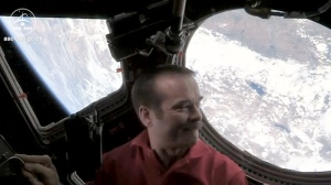 Astronaut Chris Hadfield is seen in this video taken from a YouTube video he posted Monday from the International Space Station.