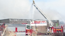 Firefighters are shown at the scene of a fire at a Dollar Store in downtown Listowel, Ont., Thursday, March 17, 2011. (Debb Coghlin / MyNews.CTV.ca)