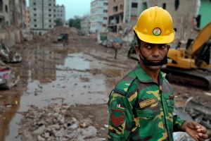 A Bangladeshi soldier stands at the site where a Bangladesh garment-factory building collapsed on April 24 in Savar, near Dhaka, Bangladesh, Monday, May 13, 2013. (AP / A.M. Ahad)
