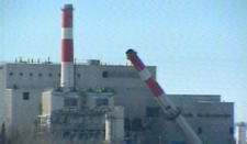 One of three smoke stacks at the Wabamun power plant falls to the ground on Friday, March 18, 2011.