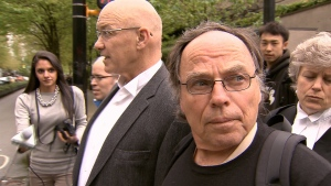 Former BC Ferries officer Karl Lilgert, right, leaves the Vancouver courthouse after being found guilty of criminal negligence causing death in the 2006 Queen of the North sinking. May 13, 2013. (CTV)