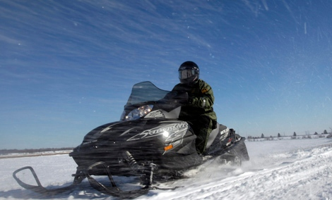 The Harper Conservatives have invested big money into snowmobile clubs while snubbing a new arena for Quebec City (AP Photo/Mike Groll)