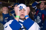 Toronto Maple Leafs fans react to the Boston Bruins fourth goal while watching Game 7 third period NHL action against the Boston Bruins at Maple Leafs Square in Toronto on Monday, May 13, 2013. (Frank Gunn / THE CANADIAN PRESS)
