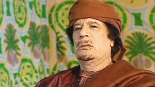Libyan leader Moammar Gadhafi is seen during an interview as he comments on the prospects of a United Nations resolution against Libyan government forces in Tripoli, Libya, Thursday March 17, 2011. (RTP Portugal TV)
