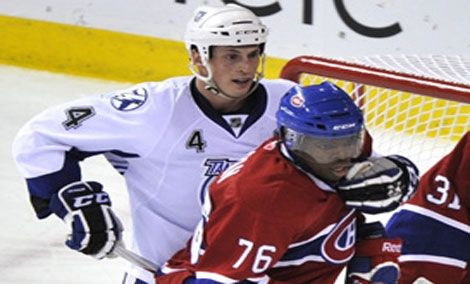 Tampa Bay Lightning's Vincent Lecavalier holds on to Montreal Canadiens' P.K. Subban during first period NHL hockey action Thursday, March 17, 2011 in Montreal. THE CANADIAN PRESS/Paul Chiasson