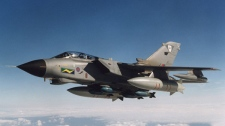 This undated image made available by the Ministry of Defence in London, Friday March 18, 2011, shows a Tornado GR4 of the Royal Air Force, one of the types of aircraft designated to take part in the operation of a no-fly zone over Libya. (AP / Ministry of Defence)