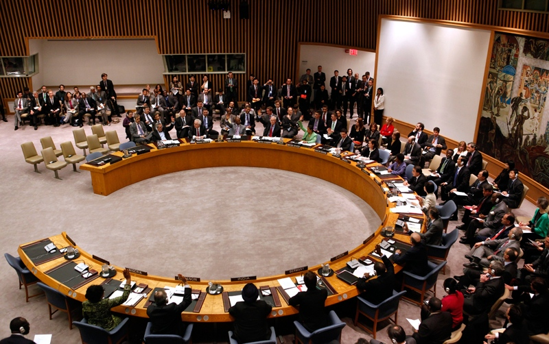 Member states vote to approve a resolution that will impose a no-fly zone over Libya during a meeting of the United Nations Security Council at UN headquarters Thursday, March 17, 2011. (AP / Jason DeCrow)