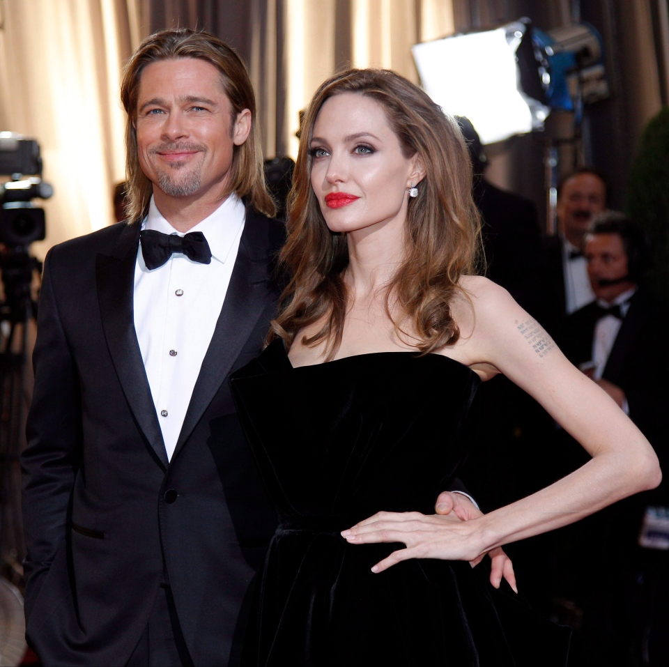 In this Feb. 26, 2012 file photo, Brad Pitt, left, and Angelina Jolie arrive before the 84th Academy Awards, in the Hollywood section of Los Angeles. (AP Photo/Amy Sancetta, File)