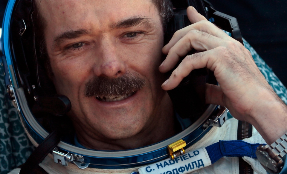 Canadian astronaut Chris Hadfield, speaks on cell phone shortly after the landing of the Russian Soyuz TMA-07 space capsule about 150 km south-east of the Kazakh town of Dzhezkazgan, Tuesday, May 14, 2013. (AP / Mikhail Metzel)