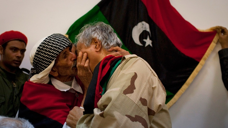 A Libyan man kisses senior Rebel commander Khalifa Hafter in the court house in the centre of Benghazi, eastern Libya, Friday, March 18, 2011. (AP / Anja Niedringhaus)