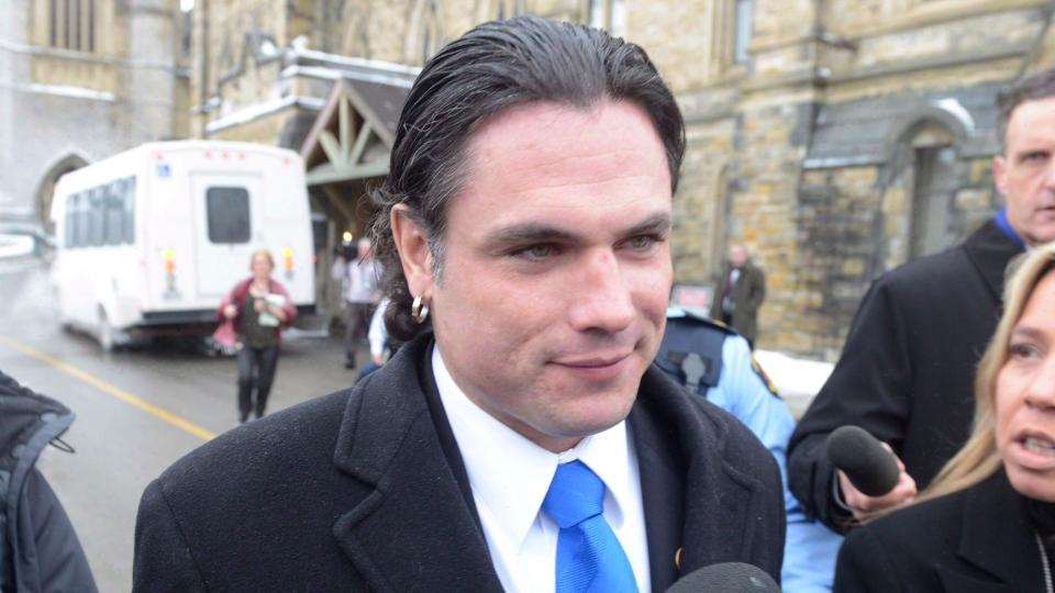 Sen. Patrick Brazeau talks to media on Parliament Hill in Ottawa, Tuesday, Feb.12, 2013. (Adrian Wyld / THE CANADIAN PRESS)