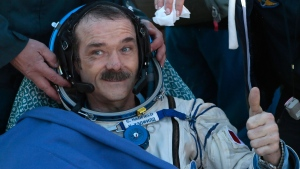 Canadian astronaut Chris Hadfield, gestures shortly after the landing of the Russian Soyuz TMA-07 space capsule about 150 km south-east of the Kazakh town of Dzhezkazgan, Tuesday, May 14, 2013. (AP / Mikhail Metzel)