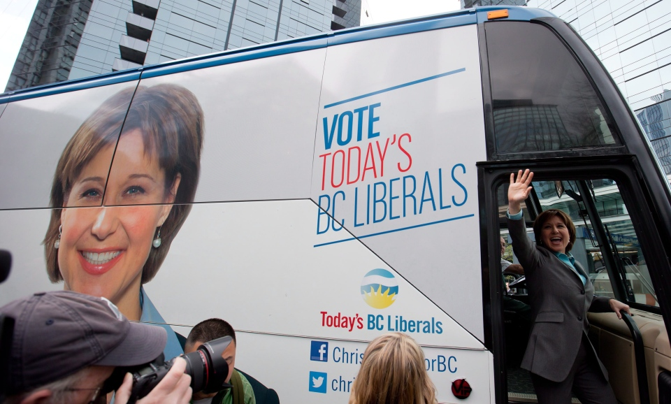 B.C. Premier Christy Clark waves as she boards her campaign bus after unveiling the B.C. Liberal party election platform in Vancouver, B.C., on Monday April 15, 2013. (THE CANADIAN PRESS/Darryl Dyck)