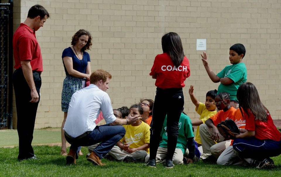 Mark Texeria, left, of the New York Yankees, joins Prince Harry, third from left, as he talks with young players while participating in a baseball clinic during the launch of a new partnership between the Royal Foundation of the Duke and Duchess of Cambridge and Harlem RBI, a local community organization, in New York, Tuesday, May 14, 2013. (AP / Justin Lane)
